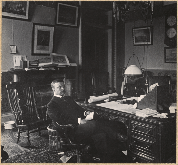 Theodore Roosevelt at his desk during his tenure as Assistant Secretary of the Navy.